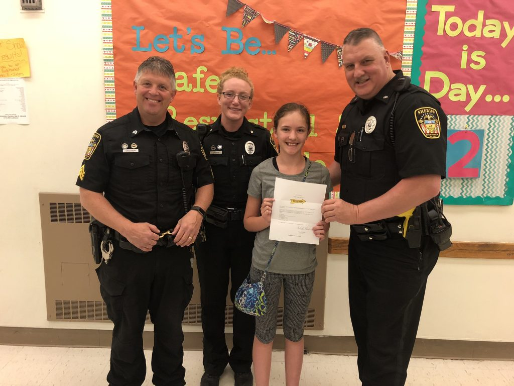 1st Place: Makayla McLister (Butler Middle School). Makayla received Kennywood Tickets for a family of four and a $5.00 Gift Certificate for King Cone Ice Cream. In photo: Sgt. Harry Callithen, Deputy Rachel Sporrer, Makayla McLister, Deputy Anthony Sawl.