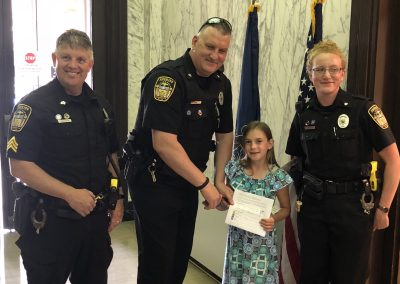 2nd Place: Jocelyn Oesterling (Butler First Baptist Christian School). Jocelyn received tickets to the Pittsburgh Museum for a Family of 6 and a $5.00 Gift Certificate for King Cone Ice Cream. In photo: Sgt. Harry Callithen, Deputy Anthony Sawl, Jocelyn Oesterling, Deputy Rachel Sporrer.