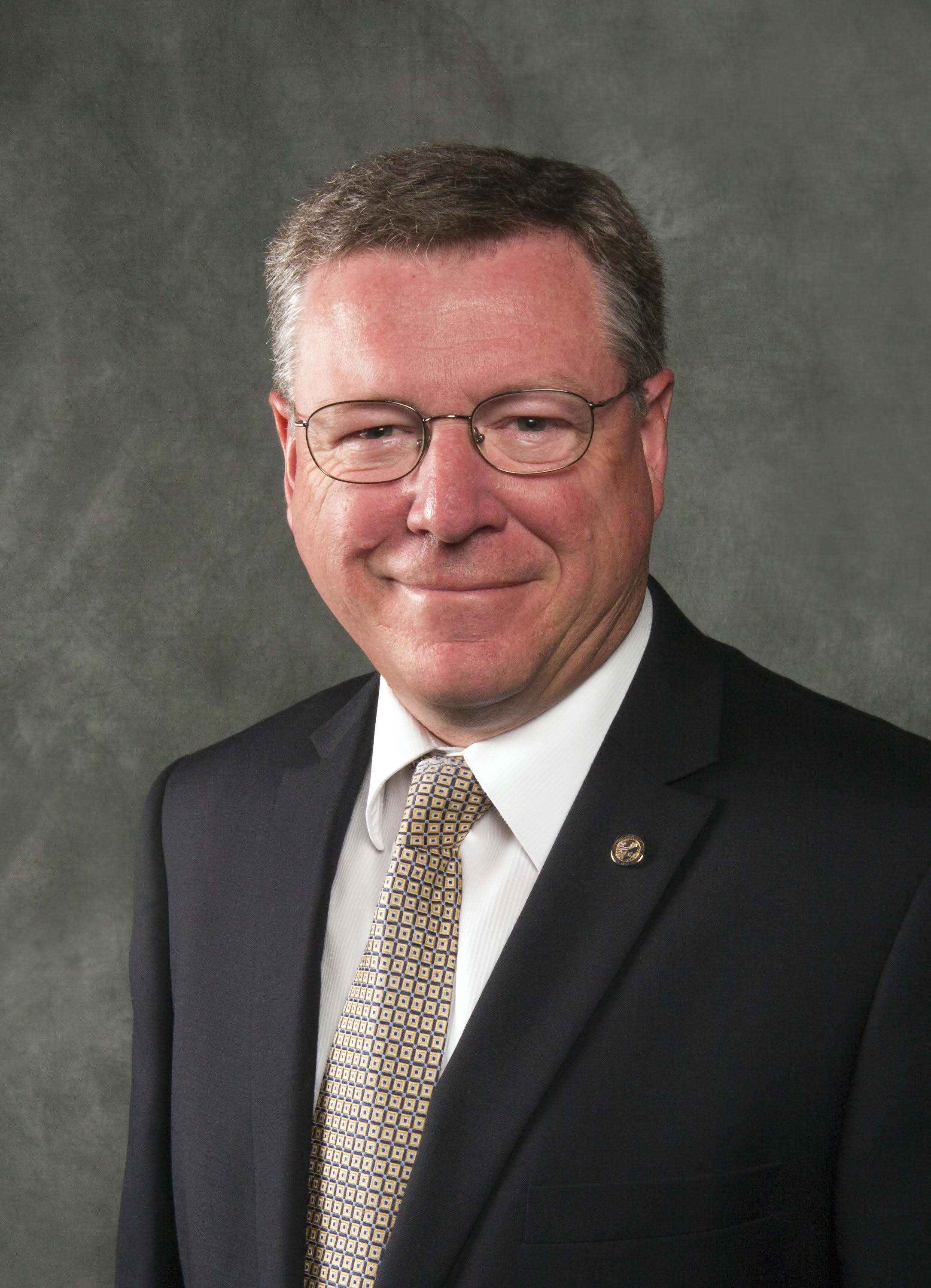 Kim W. Hawkes