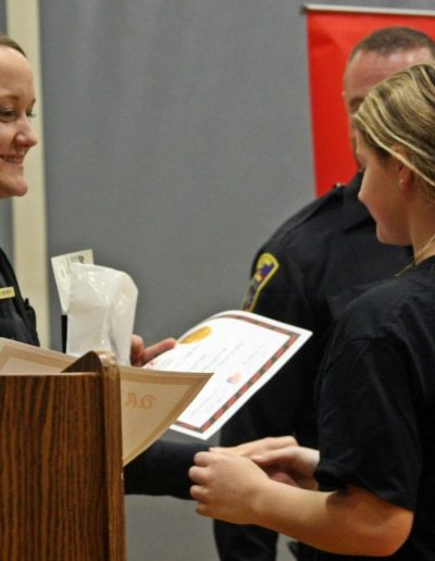 Caidence Hanson Accepts Her D.A.R.E. Certificate