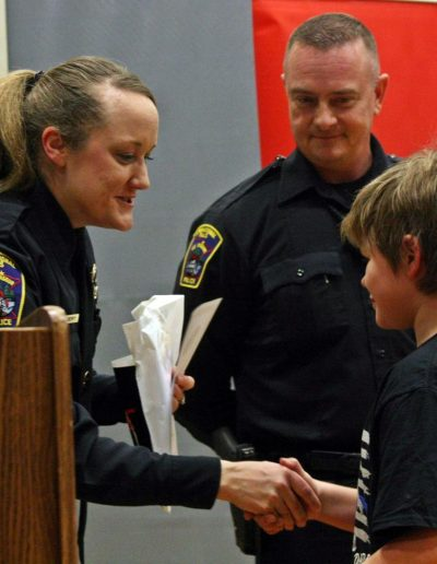 Tucker Lucek Accepts His D.A.R.E. Certificate