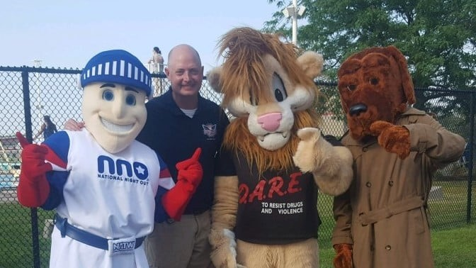 D.A.R.E. Officer James Ghrist of Munster Police Department with Daren the Lion, Nat the Knight and McGruff the Crime Dog